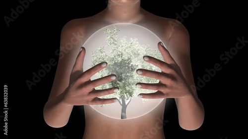 Woman holding a glowing sphere filled with a tree.