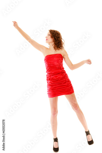 Full length woman in dress holding imaginary balloons flying