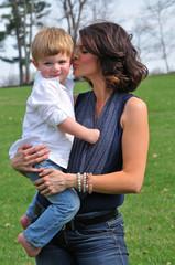 loving mother kissing her child