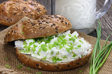 Bread roll with cottage cheese and chives