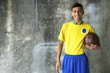 Smiling Young Brazilian Soccer Player Uniform Holding Football