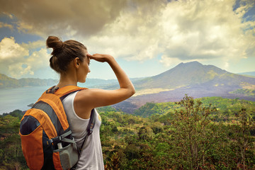 Woman traveler looking at Batur volcano. Indonesia