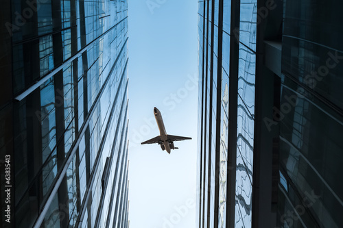 glass skyscraper and airplane