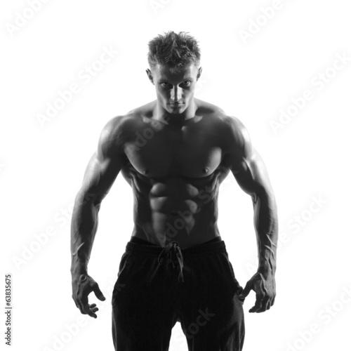strong athletic man on white background