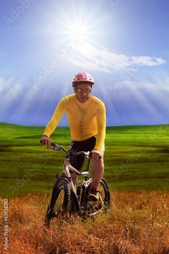young man wearing yellow bicycle shirt  riding mountain bike mtb