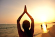fitness yoga woman sunrise . sunset seaside beach