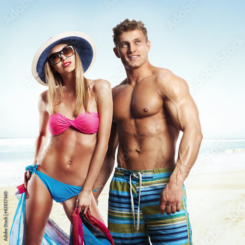 Happy beautiful couple enjoying on the beach