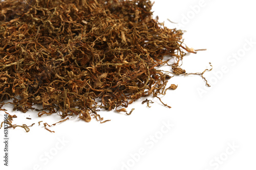 Dried shredded tobacco isolated on white background