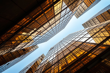 Upwards shot of Hong Kong office buildings reflecting light