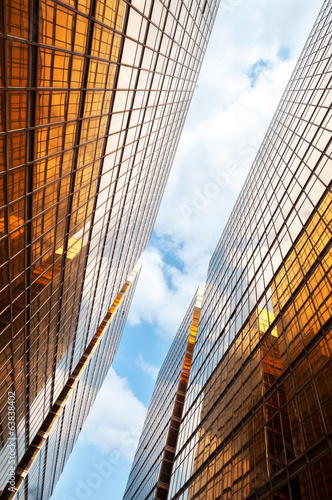 Mirrored office buildings with blue sky and clouds, Hong Kong