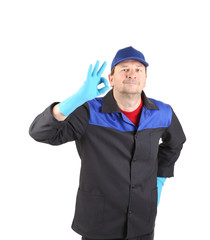 Man in blue gloves show ok sign.