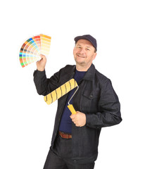 Worker with color samples and roller.
