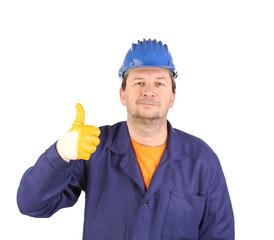 Man in yellow gloves show thumb up.