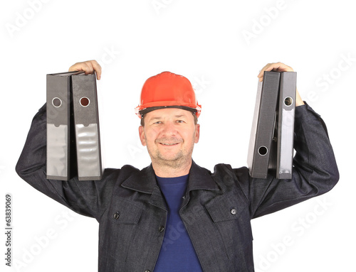 Man in coat holding folders.