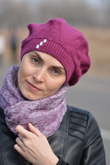 Woman in pink beret and black leather jacket on a walk