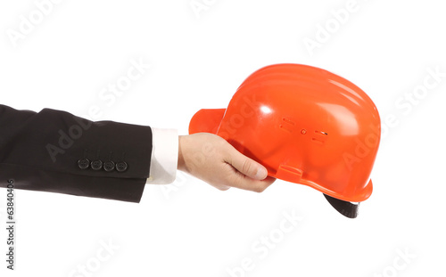 Hand holding out the construction orange helmet.