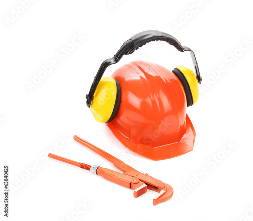 Protective helmet with headphones and wrench key.