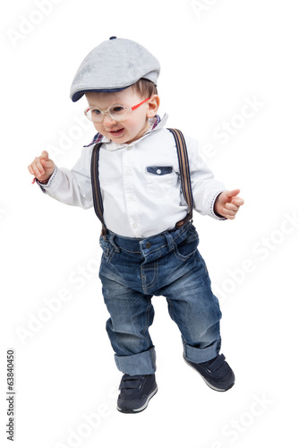 Happy baby boy with eyeglasses, suspenders and hat, isolated