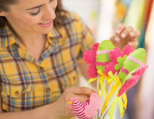Closeup on young woman making easter decoration
