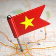 Vietnam Small Flag on a Map Background.