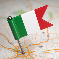 Italy Small Flag on a Map Background.