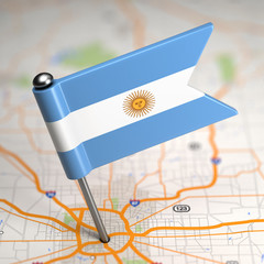Argentina Small Flag on a Map Background.