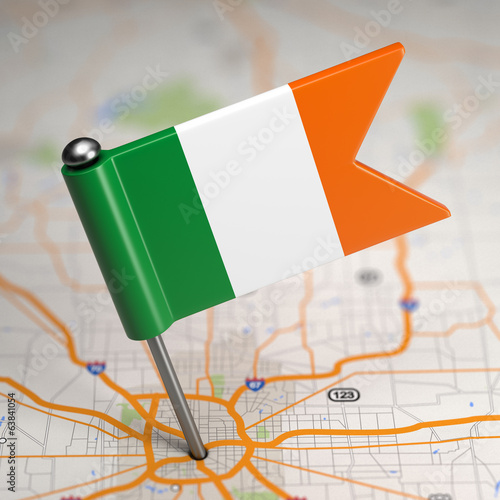 Ireland Small Flag on a Map Background.