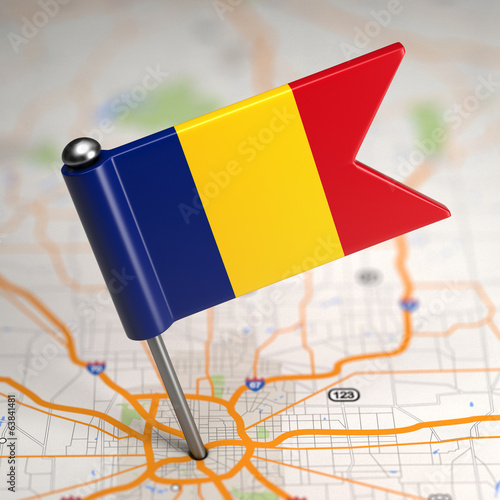 Romania Small Flag on a Map Background.