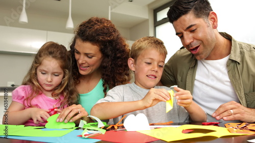 Parents and children doing arts in the kitchen
