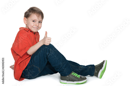Smiling preschool boy with his thumb up