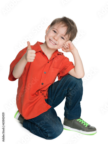 Smiling fashion boy with his thumb up