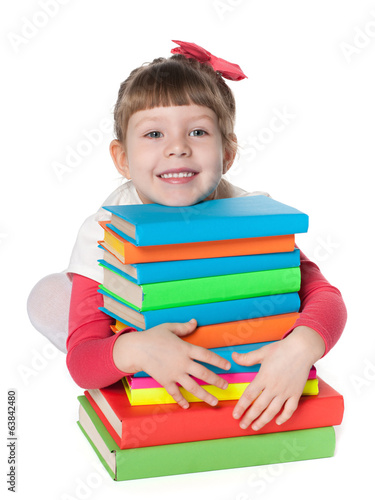 Clever little girl near books