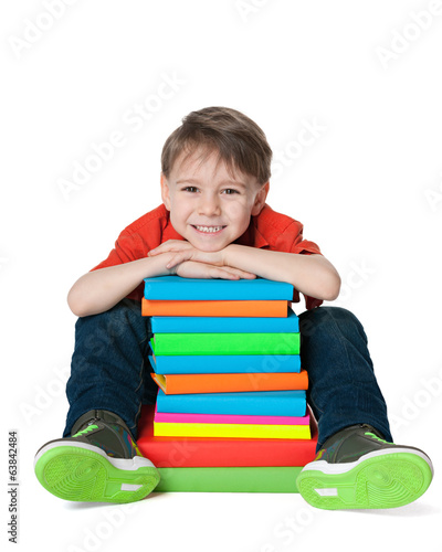 Laughing cute boy with books