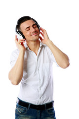 Man with headphones listening to music over white background