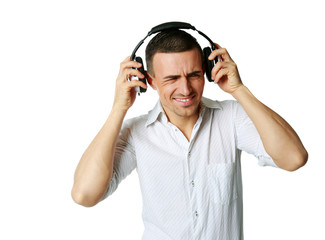 A man not enjoying what he is hearing, listening to music
