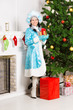 Snow maiden near christmas fir