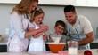 Parents baking with their children