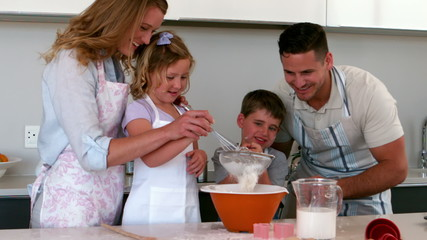 Parents baking with their children