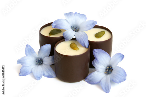 Chocolate sweets with blue flowers of hyacinth