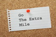 Go The Extra Mile reminder on a cork notice board