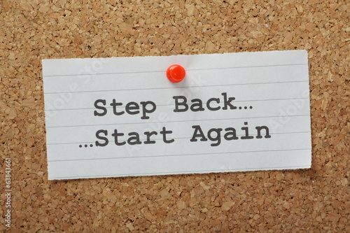 The phrase Step Back and Start Again on a notice board