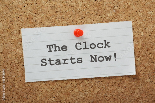 The Clock Starts Now on a cork notice board