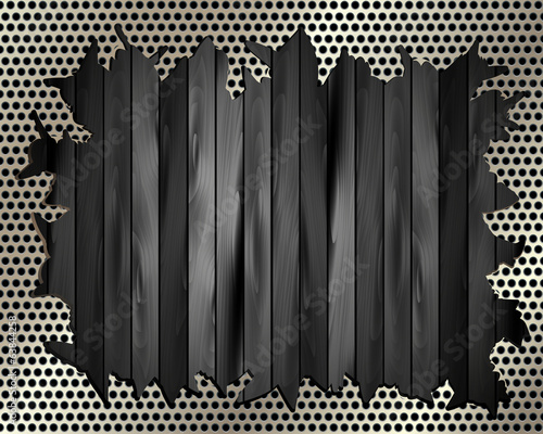 Torn metal grille on a wooden background 2