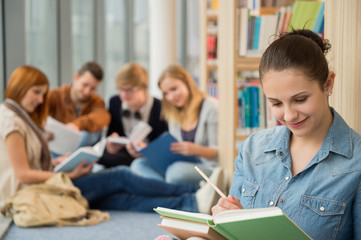 School student studying in library