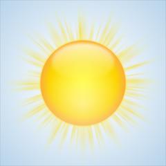 Strahlende, gelb-orange Sonne vor blauem Himmel