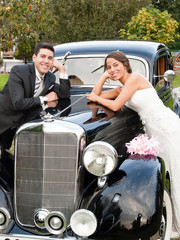 Bride and groom and a classic car