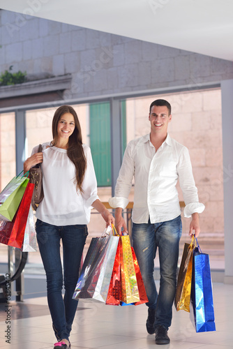 happy young couple in shopping