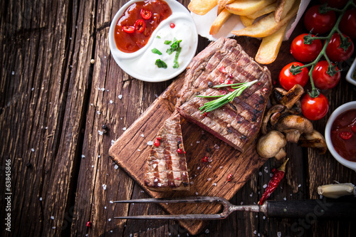 canvas print picture Beef steak on wooden table