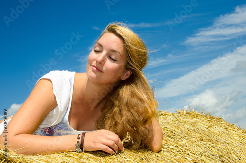 Beautiful young woman enjoys the summer