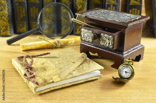 Old box with notepad and pocket watch